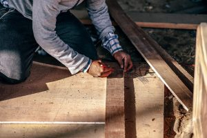 Photo: construction worker building a house